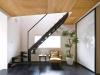 黒く塗装したスチール階段、合板の天井、黒のコルクの床材で、美しくもラフという施主好みのイメージに仕上がったリビング。